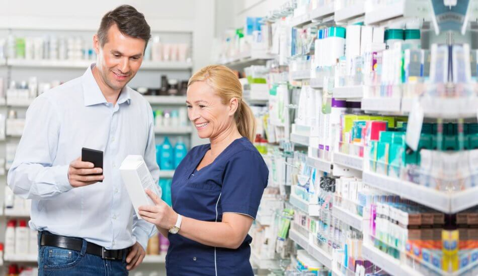 pharmacist assisting man about the medicine