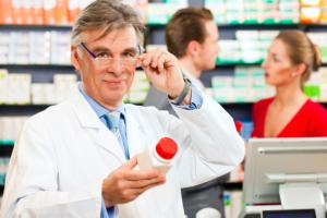 pharmacist holding a bottle of medicine