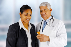 doctor showing medicine to a pharmacist