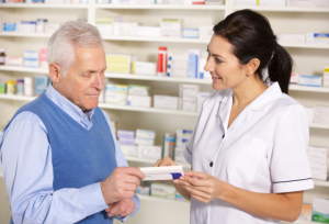 elderly man asking about medicine to a pharmacist