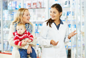 mother carrying a child inside pharmacy