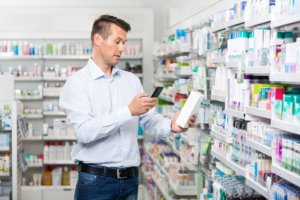 man choosing medicine